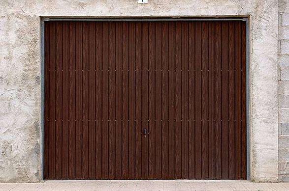 Porte de garage basculante 7 centpourcentpose for Porte de garage basculante sur mesure prix