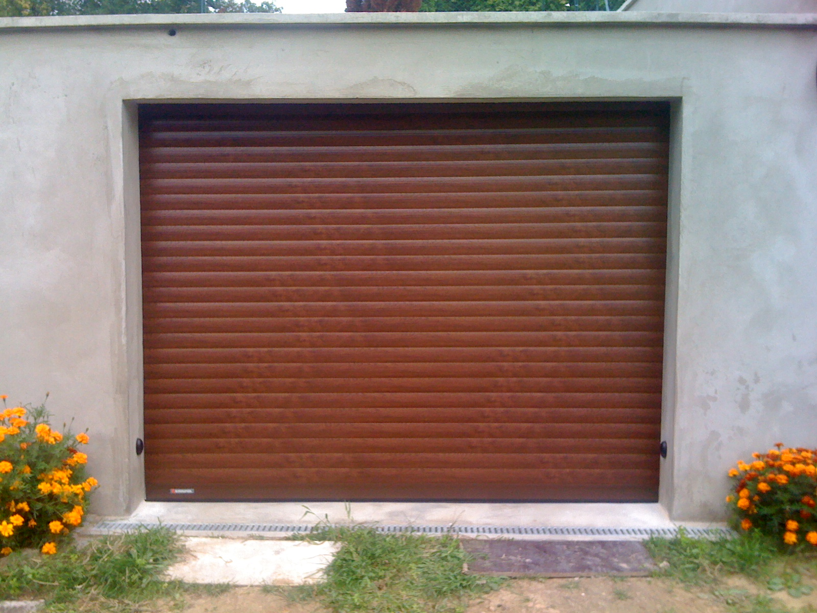 Porte garage enroulable ton bois 1 centpourcentpose for Porte garage enroulable