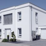 Contemporary white house with garage